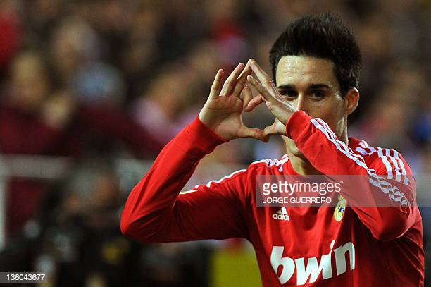 Real Madrid's midfielder Jose Maria Callejon celebrates after scoring during their Spanish league football match Sevilla FC vs Real Madrid on...