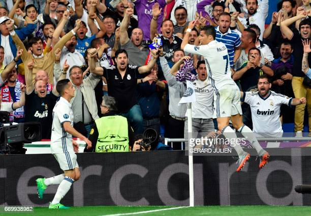 Real Madrid's midfielder Lucas Vazquez and Real Madrid's Portuguese forward Cristiano Ronaldo celebrate a goal during the UEFA Champions League...
