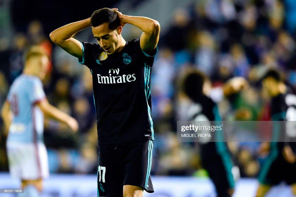 Real Madrid's midfielder Lucas Vazquez reacts after Celta Vigo's second goal during the Spanish league football match Celta de Vigo vs Real Madrid at the Balaidos stadium in Vigo on January 7, 2018. /