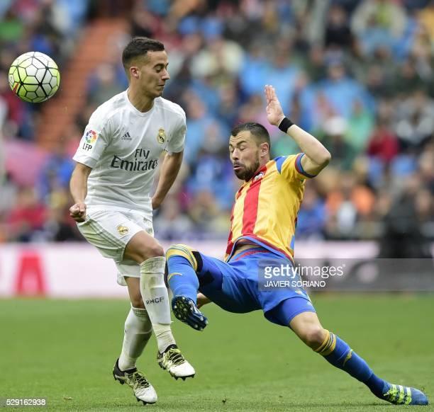 Real Madrid's midfielder Lucas Vazquez vies with Real Madrid's midfielder Lucas Vazquez vies with Valencia's midfielder Javi Fuego during the Spanish...