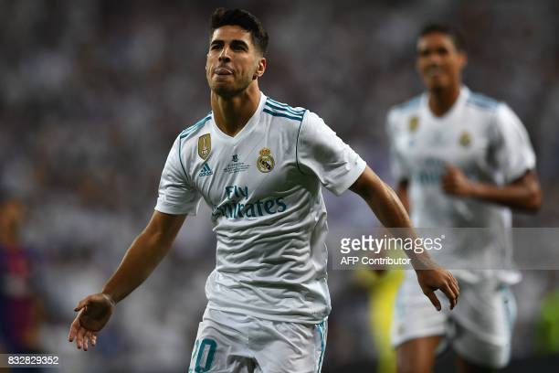 Real Madrid's midfielder Marco Asensio celebrates after scoring the opener during the second leg of the Spanish Supercup football match Real Madrid...