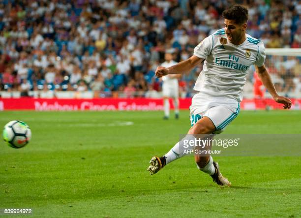 Real Madrid's midfielder Marco Asensio kicks the ball during the Spanish league football match Real Madrid CF vs Valencia CF at the Santiago Bernabeu...