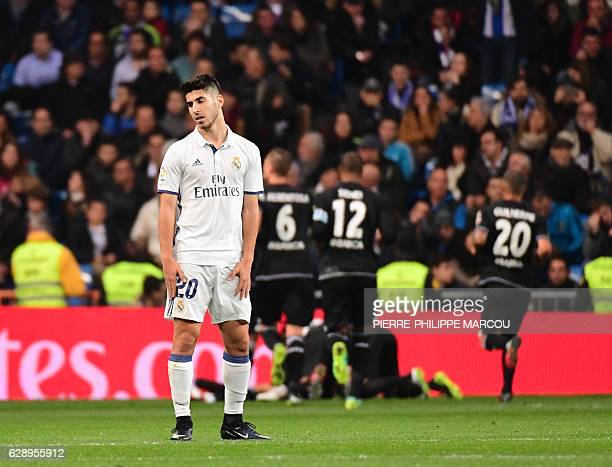 Real Madrid's midfielder Marco Asensio stands after Deportivo La Coruna's second goal during the Spanish league football match Real Madrid CF vs RC...