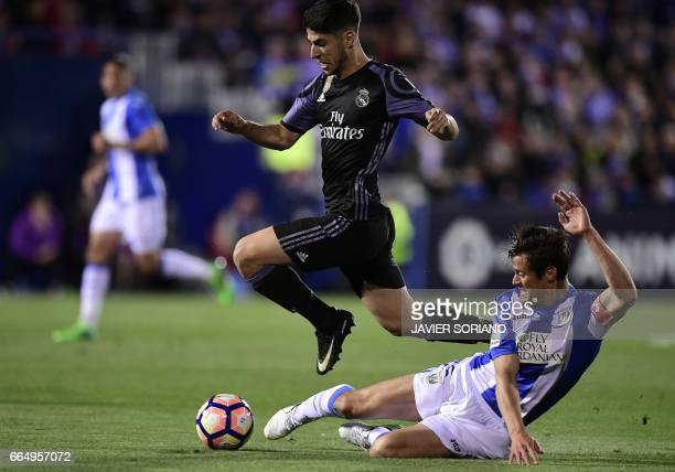 Real Madrid's midfielder Marco Asensio vies with Leganes' Argentinian defender Martin Mantovani during the Spanish league football match Club...