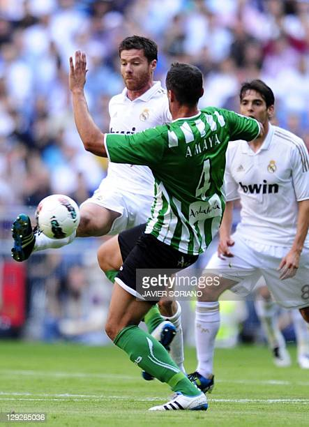 Real Madrid's midfielder Xabi Alonso vies with Real Betis' defender Antonio Amaya during the Spanish League football match Real Madrid against Betis...