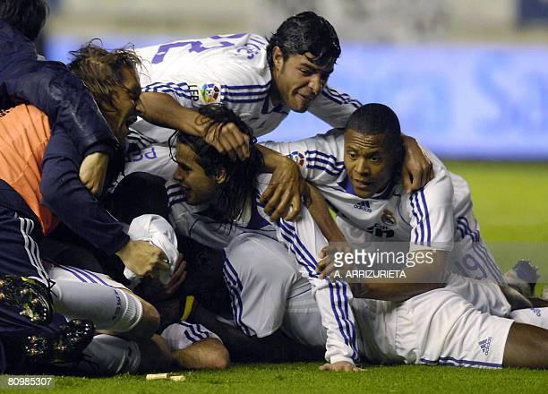 Real Madrid's Miguel Torres celebrates with teammates after winning against Osasuna during their Spanish league football match on May 4 2008 in...