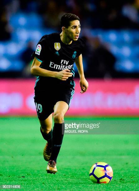 Real Madrid's Moroccan defender Achraf Hakimi runs with the ball during the Spanish league football match Celta de Vigo vs Real Madrid at the...