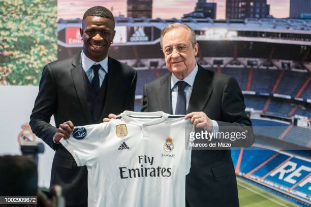 Real Madrid's new Brazilian forward Vinicius and president Florentino Perez during the official presentation in Santiago Bernabeu Stadium.