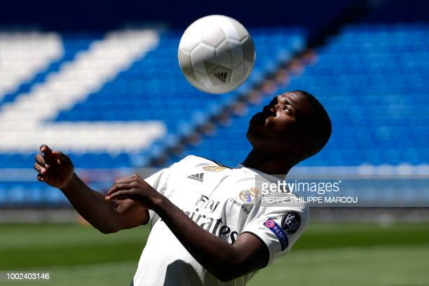 Real Madrid's new Brazilian forward Vinicius Junior controls a ball during his official presentation at the Santiago Bernabeu Stadium in Madrid on...