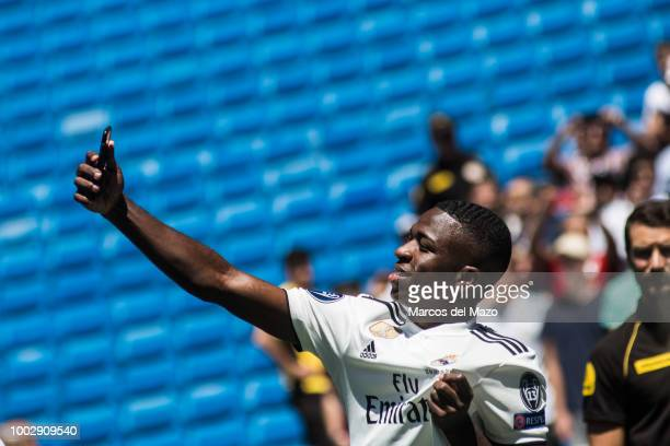Real Madrid's new Brazilian forward Vinicius Junior takes a selfie during his official presentation in Santiago Bernabeu Stadium
