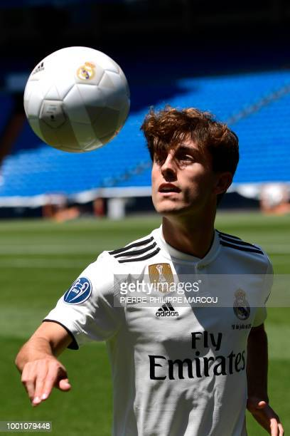 Real Madrid's new defender Alvaro Odriozola controls the ball during his official presentation at the Santiago Bernabeu stadium in Madrid on July 18...