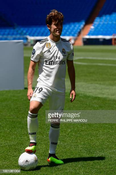 Real Madrid's new defender Alvaro Odriozola poses during his official presentation at the Santiago Bernabeu stadium in Madrid on July 18 2018