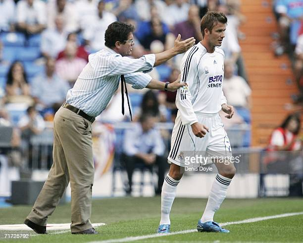 Real Madrid's new manager Fabio Capello of Italy talks to David Baecham during a Primera Liga soccer match between Real Madrid and Villarreal at the...