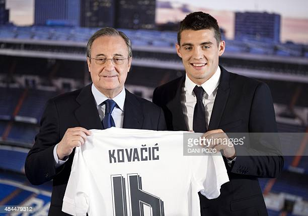 Real Madrid's new player Croatian Mateo Kovacic and Real Madrid's president Florentino Perez hold Kovacic's new jersey during his official...