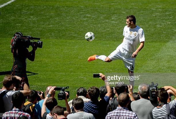 Real Madrid's new player Croatian Mateo Kovacic plays with the ball in front of fans during his official presentation at the Santiago Bernabeu...