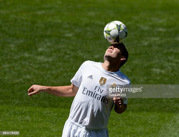 Real Madrid's new player Croatian Mateo Kovacic plays with the ball during his official presentation at the Santiago Bernabeu stadium in Madrid on...