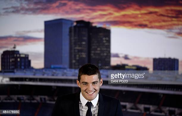 Real Madrid's new player Croatian Mateo Kovacic smiles as he gives a press conference during his official presentation at the Santiago Bernabeu...