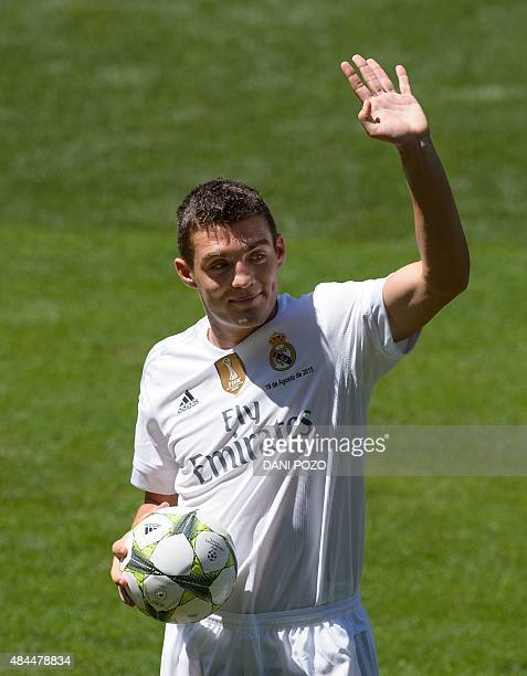 Real Madrid's new player Croatian Mateo Kovacic waves as he poses during his official presentation at the Santiago Bernabeu stadium in Madrid on...