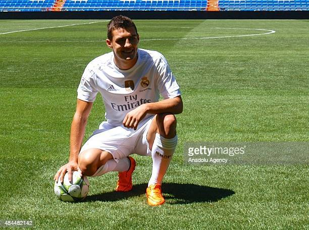 Real Madrid's new player Croatian midfielder Mateo Kovacic poses during his presentation at Santiago Bernabeu in Madrid Spain on August 19 2015 Real...