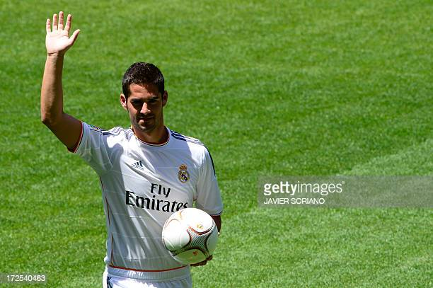 """Real Madrid's new player Francisco Roman Alarcon """"Isco"""" poses during his official presentation at the Santiago Bernabeu stadium in Madrid on July 3,..."""