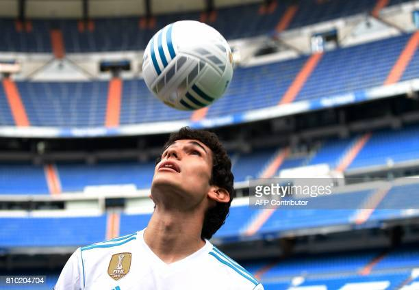 Real Madrid's new player Jesus Vallejo plays with a ball after his official presentation at the Santiago Bernabeu stadium in Madrid, on July 7, 2017....