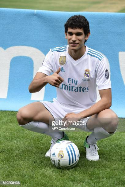 Real Madrid's new player Jesus Vallejo poses with the ball after his official presentation at the Santiago Bernabeu stadium in Madrid, on July 7,...