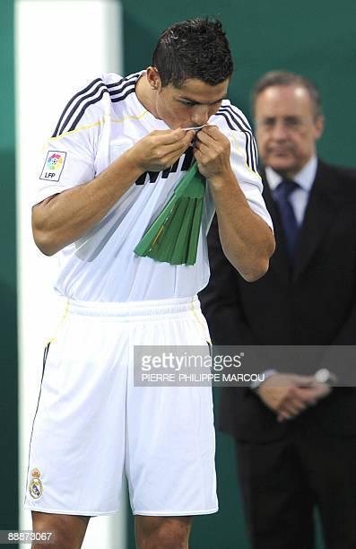Real Madrid's new player Portuguese Cristiano Ronaldo kisses his new jersey number 9 during his official presentation at the Santiago Bernabeu...