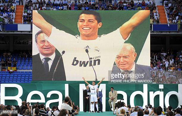 Real Madrid's new player Portuguese Cristiano Ronaldo waves to supporters during his official presentation at the Santiago Bernabeu stadium in Madrid...
