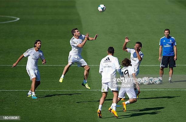 Real Madrid's new signing Gareth Bale heads the ball during a team training session on September 13 2013 in Madrid Spain