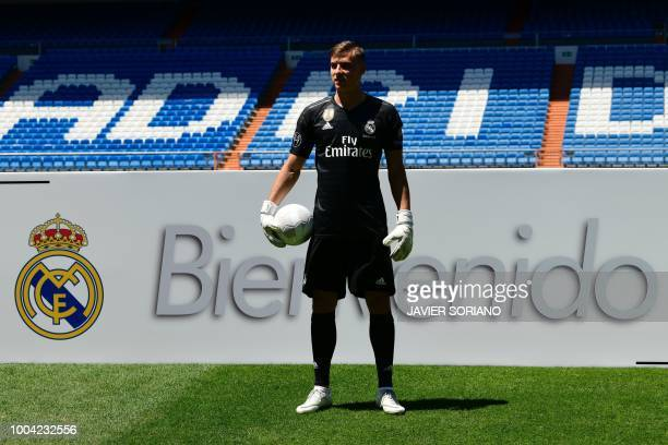 Real Madrid's new Ukrainian goalkeeper Andriy Lunin poses on the pitch during his official presentation at the Santiago Bernabeu Stadium in Madrid on...