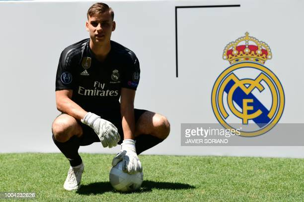 TOPSHOT Real Madrid's new Ukrainian goalkeeper Andriy Lunin poses on the pitch during his official presentation at the Santiago Bernabeu Stadium in...