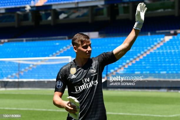 Real Madrid's new Ukrainian goalkeeper Andriy Lunin waves as he arrives to pose on the pitch during his official presentation at the Santiago...