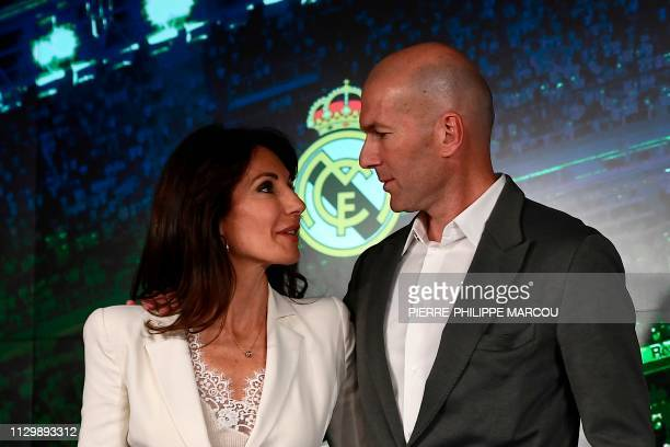 TOPSHOT Real Madrid´s newly appointed French coach Zinedine Zidane poses with his wife Veronique after giving a press conference on March 11 2019 in...