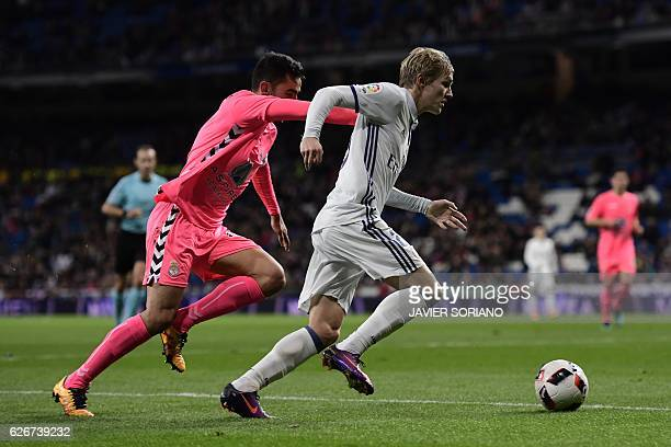 Real Madrid's Norwegian forward Martin Odegaard vies with Cultural Leonesa's defender Victor Diaz during the Spanish Copa del Rey Round of 32 second...
