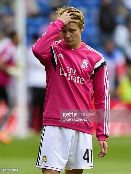 Real Madrid's Norwegian midfielder Martin Oedegaard gestures during a warm up before the Spanish league football match Real Madrid CF vs UD Almeria...