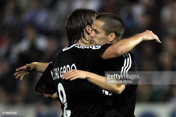 Real Madrid's Owen and Michel Salgado celebrate a goal against Malaga C.F. During their Spanish League match at La Rosaleda stadium in Malaga, 11...
