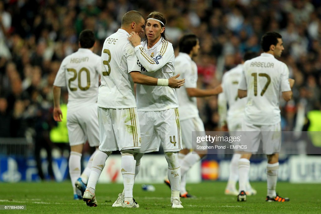 Real Madrid s Pepe consoles team mate Sergio Ramos (right) who missed a  penalty during fc7014d4d2b