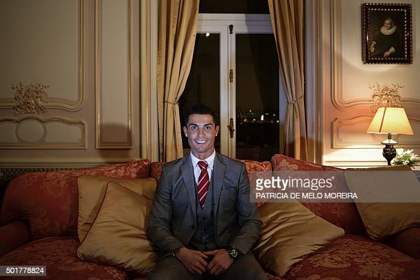 Real Madrid's player Cristiano Ronaldo smiles as he poses for a photo after attending an AFP interview at Pestana Hotel Palace in Lisbon on December...