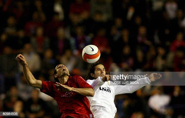 Real Madrid's player Gago vies with Osasuna's player Astudillo during their Spanish League match at the Reyno de Navarra stadium in Pamplona on May 4...