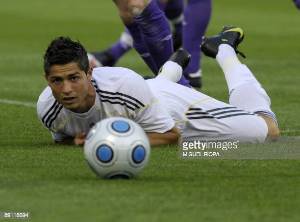 Real Madrid's player Portuguese Cristiano Ronaldo watches the ball during a friendly football match against Shamrock Rovers on July 20 2009 at the...