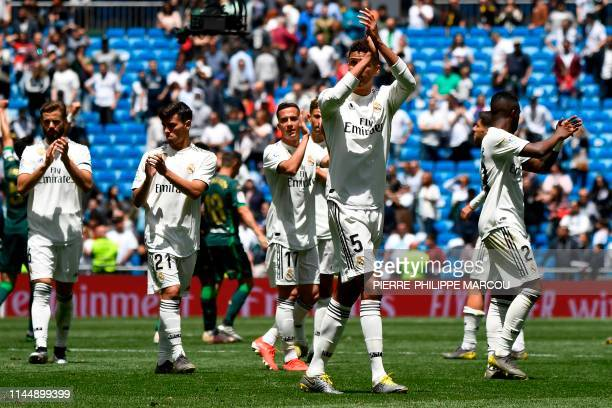 TOPSHOT Real Madrid's players acknowledge fans at the end of the Spanish League football match between Real Madrid and Real Betis at the Santiago...