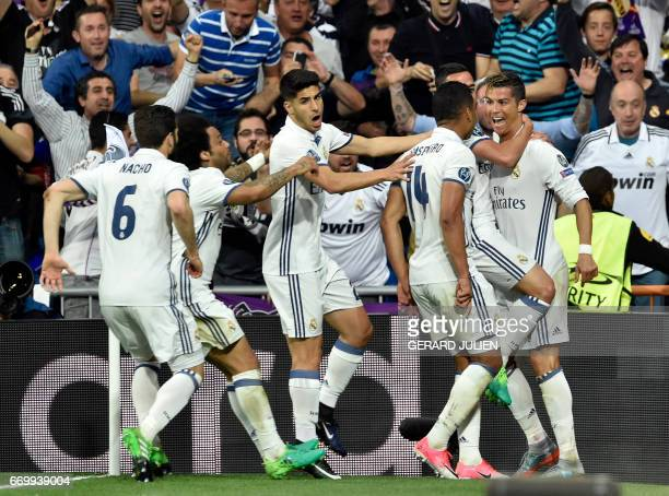 Real Madrid's players celebrate a goal by Real Madrid's Portuguese forward Cristiano Ronaldo celebrate during the UEFA Champions League quarterfinal...