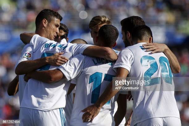 Real Madrid's players celebrate a goal during the Spanish league football match Getafe CF vs Real Madrid at the Coliseum Alfonso Perez stadium in...
