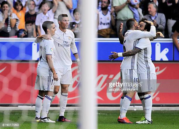 Real Madrid's players celebrate after Portuguese forward Cristiano Ronaldo scored his team's fourth goal during the Spanish league football match...