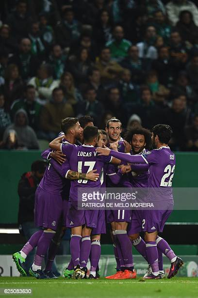 Real Madrid's players celebrate after Real Madrid's French defender Raphael Varane scored during the UEFA Champions League football match Sporting CP...