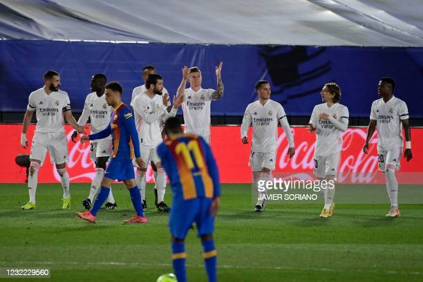 """Real Madrid´s players celebrate after Real Madrid's German midfielder Toni Kroos scored during the """"El Clasico"""" Spanish League football match between..."""