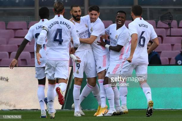 Real Madrid's players celebrate after scoring a goal during the Spanish League football match between Barcelona and Real Madrid at the Camp Nou...