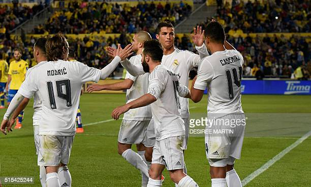 Real Madrid's players celebrate after scoring during the Spanish league football match UD Las Palmas vs Real Madrid CF at the Gran Canaria stadium in...