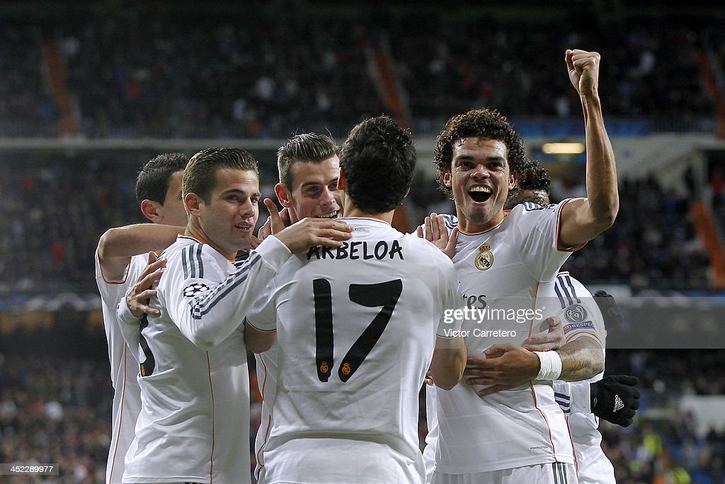 Real Madrid's players celebrate after scoring their team's first goal during the UEFA Champions League Group B match between Real Madrid and Galatasaray AS at Estadio Santiago Bernabeu on November 27, 2013 in Madrid, Spain.