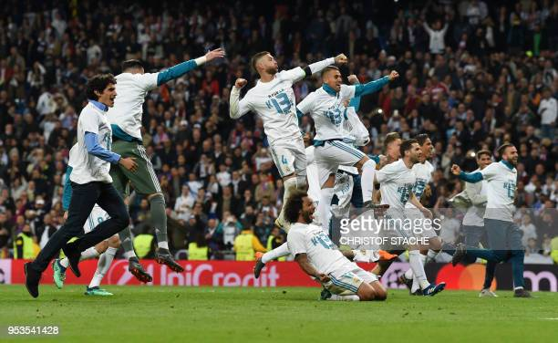 TOPSHOT Real Madrid's players celebrate after the UEFA Champions League semifinal secondleg football match Real Madrid CF vs FC Bayern Munich in...